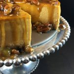 Maple pumpkin cheesecake w/maple praline pecan glaze